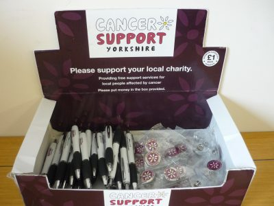 Cancer Support Yorkshire Merchandise Box containing pens and badges