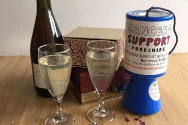 Photo of wine and and charity box