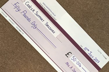 Photo of cheque donation
