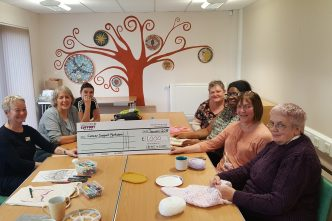 The create and chat group: Christine Stephenson, Nicole Parker, Shelley Whiteley, Angela Oldfield, Veronica Browne, Barbara Friedbach & Christine Bryant, with a cheque for £1000.00 for Cancer Support Yorkshire!